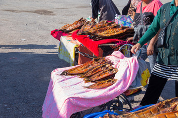 Kazakhstan, June 22, 2019. On the highway Nursultan-Almaty, the city of Balkhash, women sell smoked fish on the street right on the road