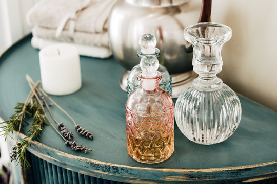 Decorative Crystal Bottles on Rustic Table