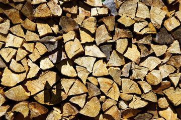 Background or texture symmetric with pieces of wood for stove fireplace and ax.