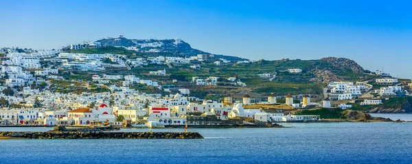 Mykonos, Greece famous island panorama banner with whitewashed houses, windmills, view from the sea in Cyclades