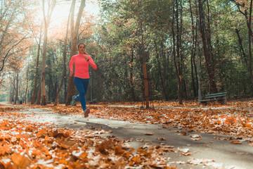 Woman Jogging Outdoors. Park, Nature