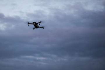 Drone in the sky. Unmanned aerial vehicle flying in the air