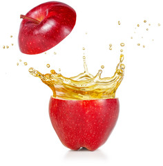 Wall Mural - transparent juice squirting out of a red apple isolated on white