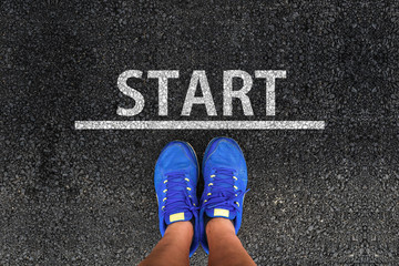 Start. man with a shoes is standing next to line and word START