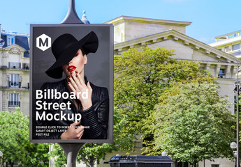 Billboard on City Street with Trees Mockup