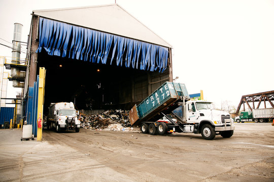 Truck dumping garbage at recycling plant