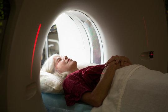 Woman going through MRI scanner
