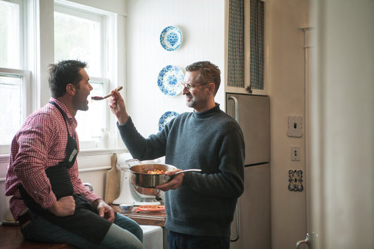Mature men sharing meal