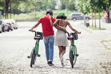 Rear view of couple with bicycles