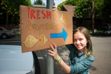 Girl (10-11) with Lemonade Stand Sign