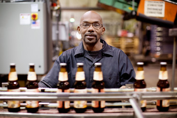 Brewery worker at assembly line