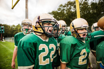 American football players shouting in field