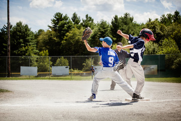 Baseball players playing in field