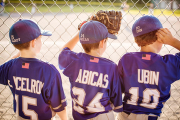 Rear view of baseball players looking at field