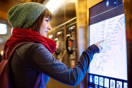 Young woman checking subway map