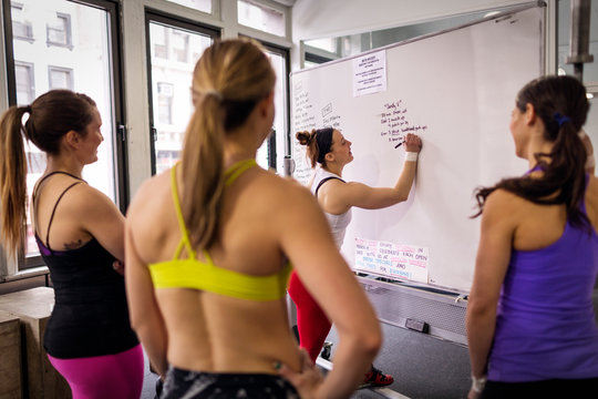 Instructor talking with young women