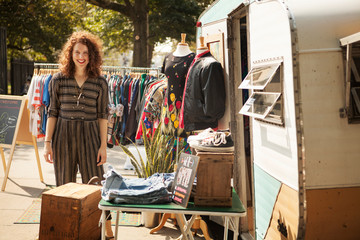 Vintage store owner standing by her boutique