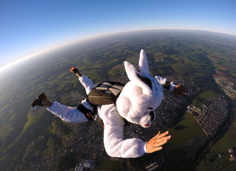 Happy easter bunny skydiver costume jumping free falling