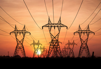electricity pylons at sunset Wall mural