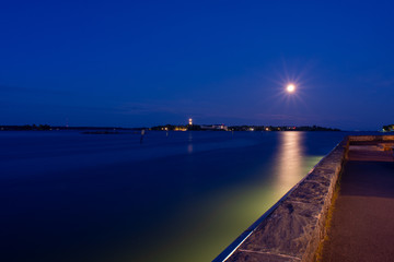 Helsinki by night: full moon above Suomenlinna island
