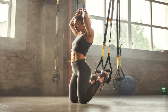 Woman doing suspension training