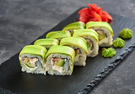 green dragon sushi roll with eel and avocado