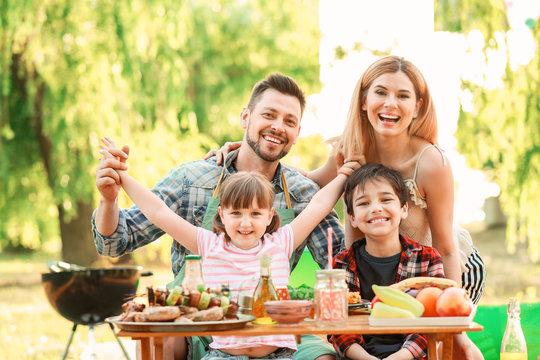 Happy family having picnic on summer day