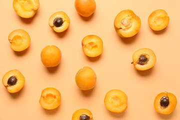 Tasty apricots on color background