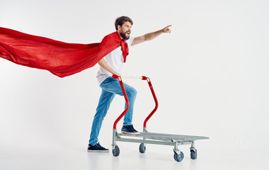 a man in a red coat on a trolley