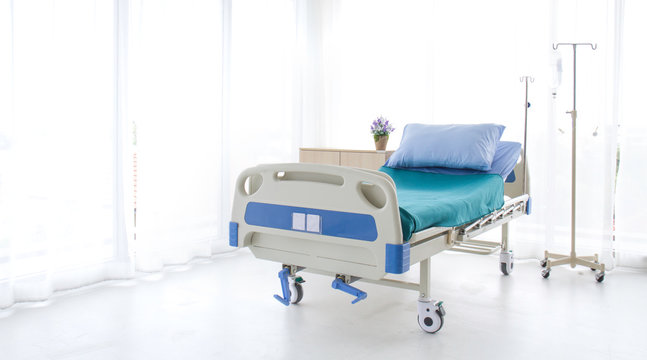 Emtry bed on hospital.blue and white hospital bed  on white background. Patient room  and insurance concept.