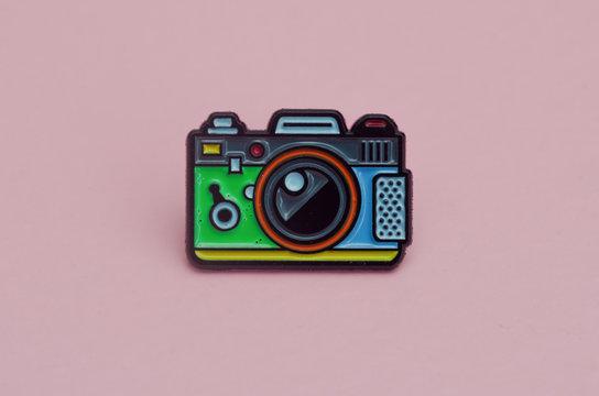 enamelled metal brooch camera icon
