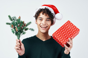 man with a spruce twig and a gift
