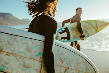Obraz Surfers going for surfing in the sea - fototapety do salonu