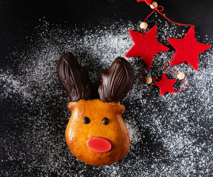 brioche deer with red nose and chocolate horns, Christmas bake