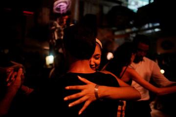 People dance tango in an art gallery in Old Havana