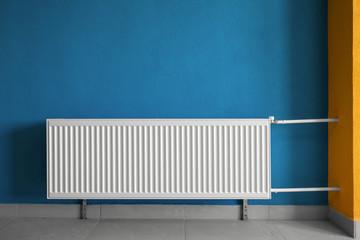 White heating radiator in public corridor at house