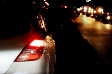 Blurred image of cars on the road with light break at night.
