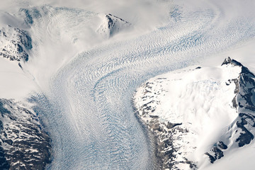 Aerial view of a glacier in the Kujalleq Municipality of Greenland. These glaciers are receding due to climate change.