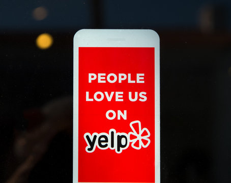 Yelp Emblem and Logo on Business Exterior
