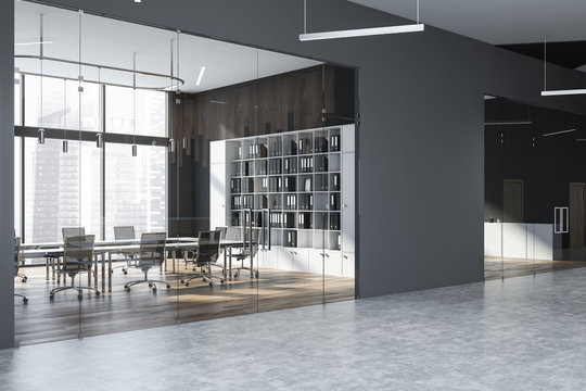 Gray meeting room with bookcase
