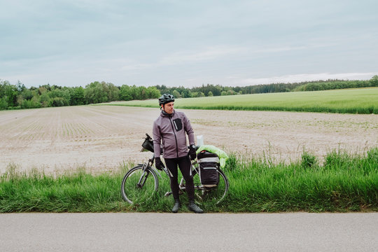 Cyclist waiting for friends in the road of Romantische Strafle route