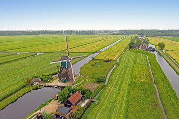 Aerial from a traditional windmill in the countryside from the Netherlands