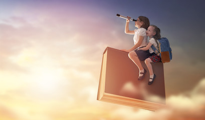 children flying on the book