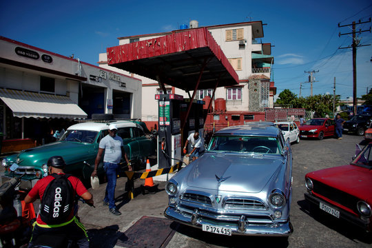 Cars line-up to buy fuel at a gas station in Havana