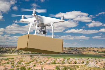 Unmanned Aircraft System (UAS) Quadcopter Drone Carrying Blank Package Over Neighborhood Wall mural