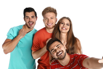 Happy young people taking selfie on white background