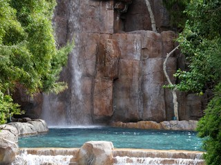 Blue waters of a pool with water cascading down a waterfalls Wall mural