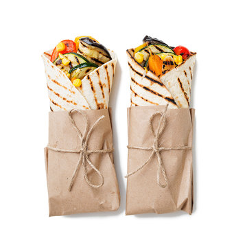 Vegan tortilla wrap, roll with grilled vegetables. isolated on white background