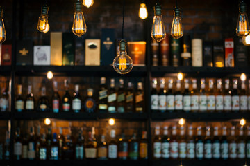 Vintage lamp with blurred liquor bar background