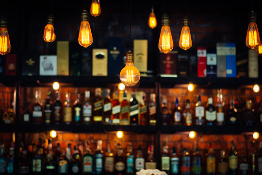 Vintage lamp with blurred liquor bar background